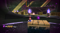 Mario about to collect the 100th Purple Coin on the underground ghost ship.