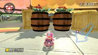 Screenshots of several racetracks from Mario Kart games, taken in places with barrels.