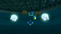 Mario fighting Kamella on the underground ghost ship.