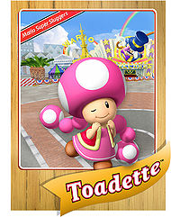 Toadette's official profile card from Mario Super Sluggers (front).